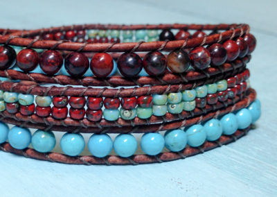 Picasso Seed beads surrounded by Poppy Jasper and Dyed Natural Turquoise