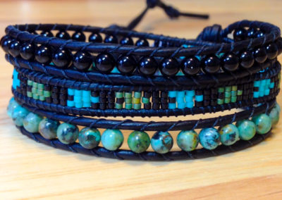 Delica Seed beads, surrounded by Black Onyx and African Turquiose