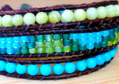 Turquoise & Green Seed Beads are surrounded byLime Green Jade & Simulated Turquoise.